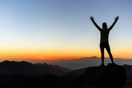 climber: Woman successful hiking climbing silhouette in mountains, motivation and inspiration in beautiful sunset and ocean. Female hiker with arms up outstretched on mountain top looking at beautiful night sunset inspirational landscape.