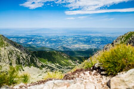 green ridge: Inspiring Mountains Landscape View, sunny day in summer Tatras. Looking at town in green valley from mountain ridge over blue sunny sky, Poland in Europe