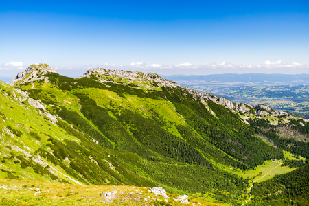 giewont: Inspiring Mountains Landscape View, sunny day in summer Tatras, mountain ridge over blue sunny sky. Looking at Giewont Mountain 1895m a.s.l., Poland Europe Stock Photo