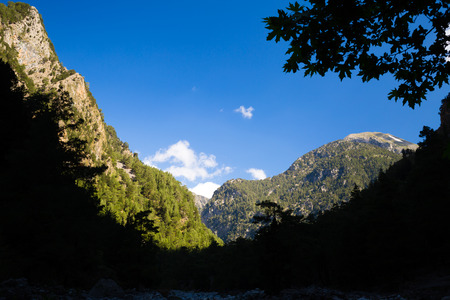 Mountains beautiful inspirational landscape in summer day. Samaria Gorge canyon in Crete Greece, Europe. Looking at view with forest silhouette.