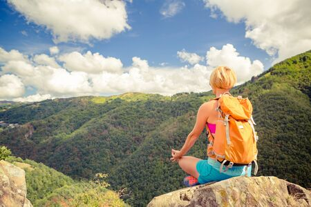 Hiking woman celebrating inspirational mountains landscape, admire and meditate. Fitness and healthy lifestyle outdoors in colorful summer nature. Trekking, camping and climbing travel concept.