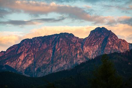 giewont: Giewont Mountain, Inspiring Mountains Landscape, beautiful day in summer Tatras, mountain ridge over blue sky in Zakopane, Poland Stock Photo
