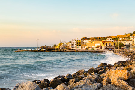 Inspirational beautiful sunrise in mediterranean town with sea, coast, beach and rocks. City of Paleochora, Crete Island, Greece.
