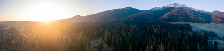 Inspiring Mountains Landscape, big panorama with beautiful sunrise and Giewont Mountain in Tatras, Zakopane Poland