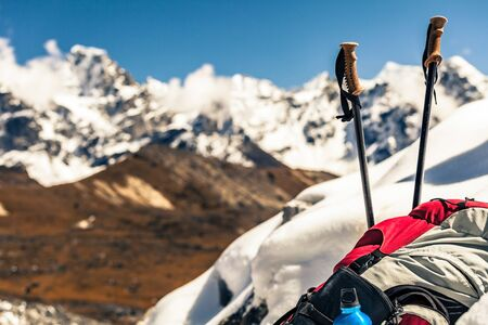 Hiking and camping equipment in Himalaya Mountains, Nepal. Beautiful inspirational mountain landscape in background.