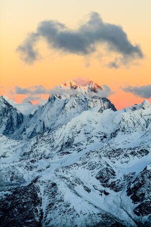 Mountain landscape in autumn or winter in Caucasus Mountains i Russia and Georgia. Mountain ridge over blue sunny sky, Russia Banco de Imagens