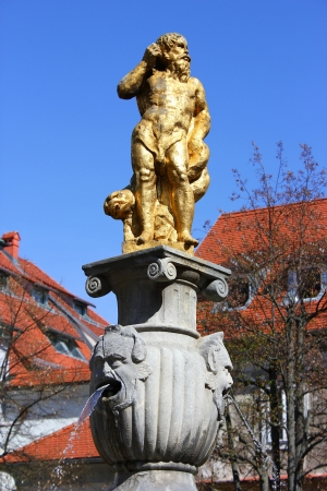 golden neptune fountain in ljubljana, slovenia