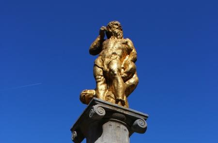 golden statue of god Neptune - Ljubljana, Slovenia