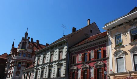 main square facades with paintings and stucco decorations - Maribor, Slovenia