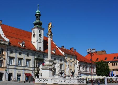 Maribor town main square with plague monument and city hall - tourist attraction of Maribor, Slovenia, European Capital of Culture 2012