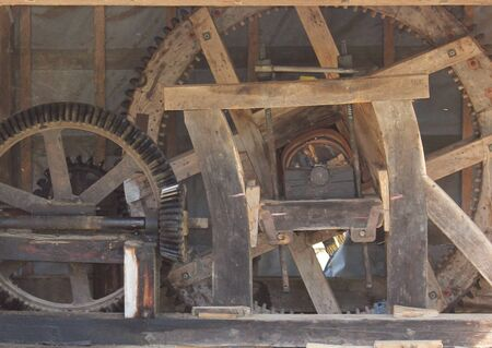 old watermill mechanism on Mura river, Slovenia photo
