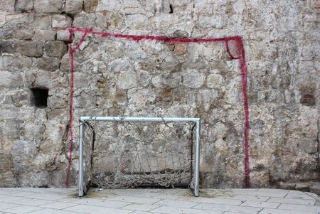 painted goalposts - street football games photo