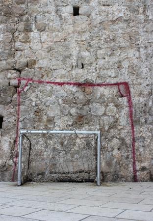 street corner: different football goal posts - urban children playground