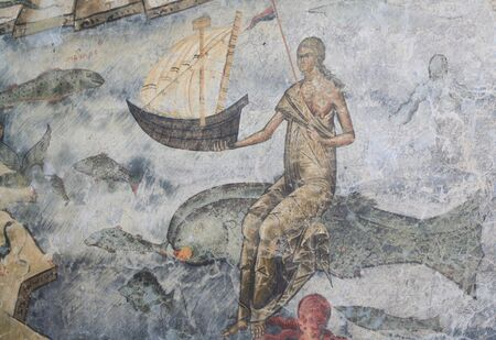 queen of the sea holding a boat and riding a fish - wall painting, Voronet church, Romania