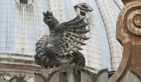 sculpture of dragon with cupola of the Saint Peter basilica in the background, Vatican City, Europe Stock Photo