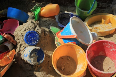 topsyturvy: sandbox full of plastic toys in vivid colours Stock Photo
