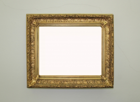 golden framed mirror on the wall photo