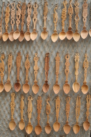 carving tool: collection of wooden spoons - romanian folk art and craft heritage Stock Photo