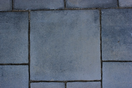 fissures: gray stone pavement with darker fissures - abstract background