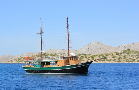 Fisherman sailing boat floating near Kornati islands, Croatia, Europe photo