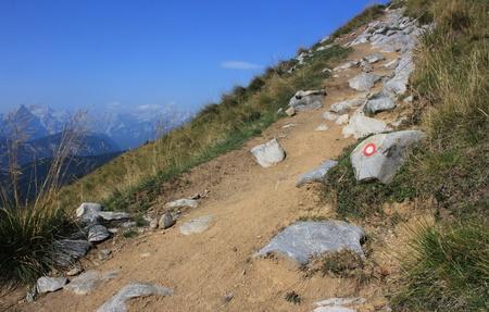 Alpine track with slovenian trail blaze, Karavanke, Slovenia - Austria border, Europe Stock Photo