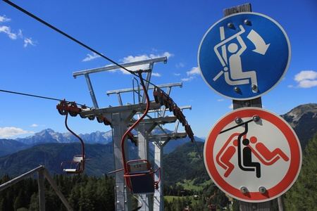 Skilift with chairlift signs, Spanov vrh, Slovenia