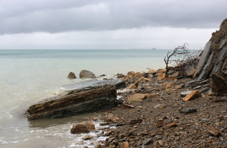 Rocky mediterranean seashore in a rainy weather, Adriatic, Slovenia