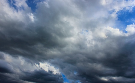 Dark blue sky filled with heavy rainy clouds