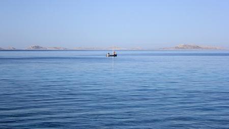 Two lonely fishermen on the Mediterranean sea, Dalmatia, Croatia