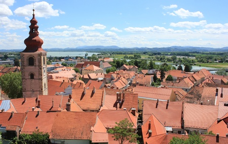 drava: Red roofs of old town center of Ptuj and river Drava in the background, Slovenia, Europe Stock Photo