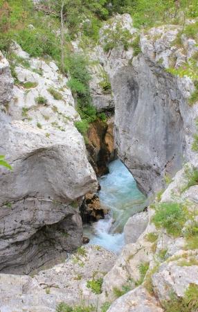 Steep and narrow riverbed of Soca river, Triglav National Park, Julian Alps, Slovenia photo