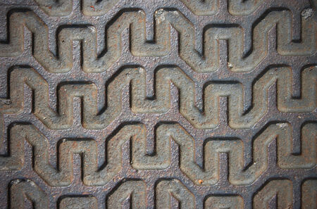 Metal linear pattern on the surface of the manhole lid detail  photo