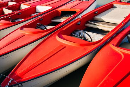 red motor boat with steering wheel for hire