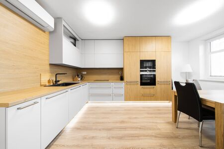 modern kitchen with black sink and air conditioning Stockfoto