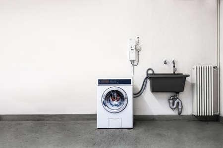 Laundry room with washing machine Stock Photo