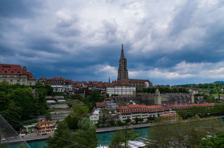 Bern city Switzerland view of the Cathedral overcast day dramatic clouds