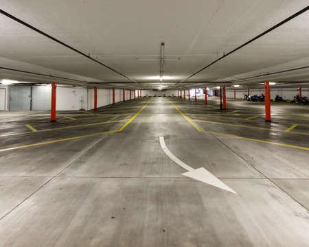 Empty illuminated undeground car park wide angle shot 2019