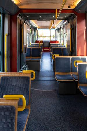 Tram car wagon coach inside empty chairs daylight in Zurich city 2019