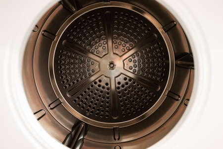 Open door bronze metal empty tumbler dryer close up shot 2020