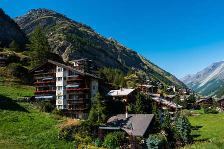 Rustic Swiss mountain resort town landscape shot mid day in the summer wide vista 2020