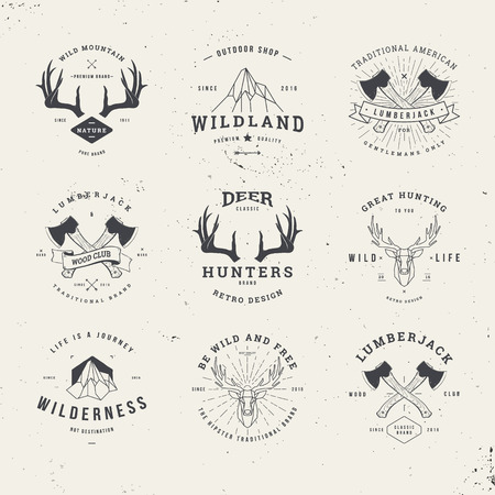 wildlife hunters, hipster logo set with deer antlers, axe and mountains Иллюстрация
