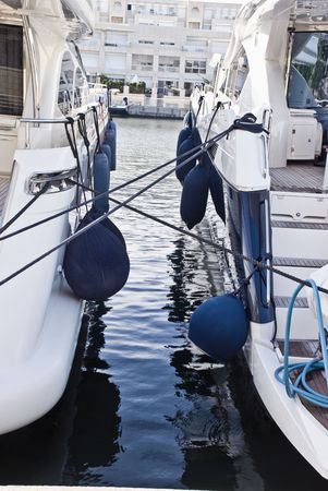 moored: Two modern motor boats moored to each other at the port