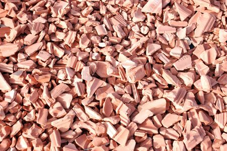 damaged roof: Broken slabs of fired clay for covering roofs or lining walls or floors   Stock Photo