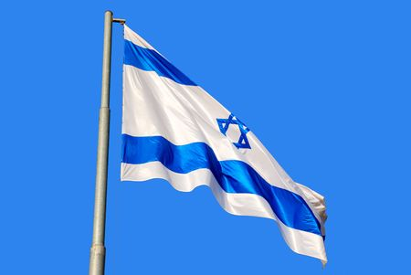 israeli: A waving Israeli flag against the blue sky background