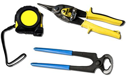 snips: A set of tape measure, tin snips and pincers over white