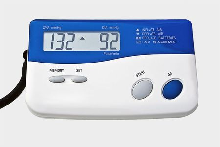 Digital blood pressure monitor isolated over white.