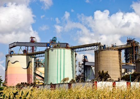 filthiness: Big colored tanks of a modern cement plant Stock Photo
