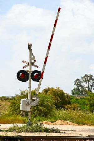 An open level crossing gate in countryside photo