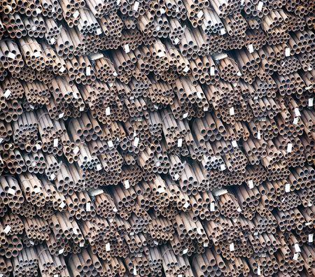 petrolium: Stock pile of different diameters metal pipes  Stock Photo