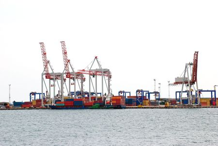 Huge cargo port cranes in their operation.